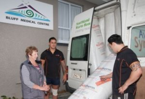 Unloading insulation at the Bluff Medical Centre public building