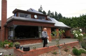 Man outside of his house that has a new Solar PV System