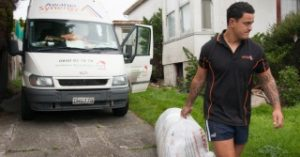 Awarua Synergy Employee removing a bag of contaminants