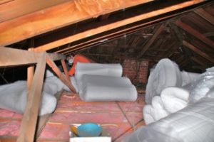 Ceiling insulation being installed in an attic