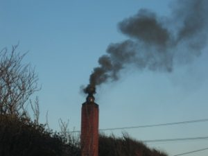 Dirty smoke coming out of a chimney