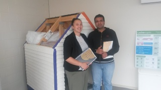 Michelle Collins and Dave Tiyagi accepting their Home Performance Advisor Certificated