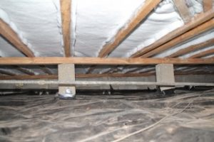 Underfloor section of a home that has been insulated