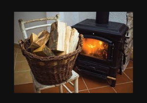 Basket of wood beside a wood-burning fireplace